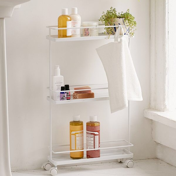 Create more storage space - If your bathroom has little to no place to put stuff away, invest in some free-standing storage like a small cart, over-the-toilet shelves, or a mini cabinet.