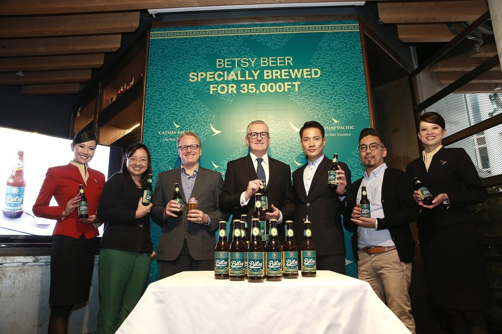 Some of the tasting panel members (from left) Aby Chiu, Cathay Pacific Flight Purser; Grace Cheung, Cathay Pacific Manager Global Marketing Communications; Devin Kimble, Director of Hong Kong Beer Co; Aaron Claxton, Cathay Pacific Head of Catering; Real Ting, co-founder of the Collaboration Group; Thomas Lau, Chairman of the Hong Kong Craft Beer Association and Crystal Chen, Cathay Pacific Inflight Service Manager celebrate the new launch of the Betsy Beer.