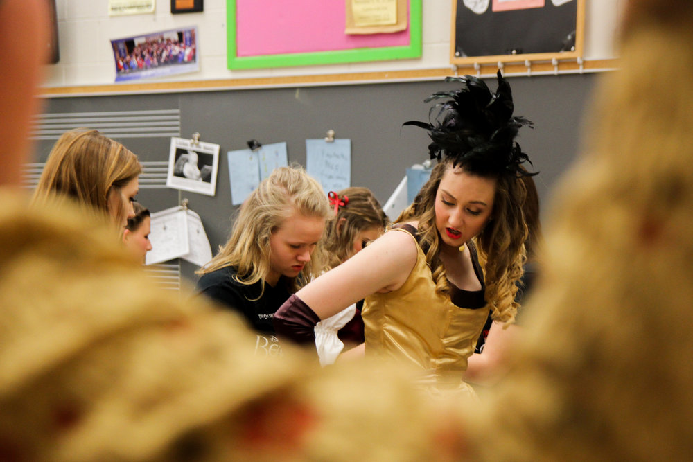 The cast of Cranberry High School's production of  Beauty and the Beast  prepares for opening night, of the four night show, for their annual spring musical. They received new costumes as well as new sound equipment for the show from the school board.