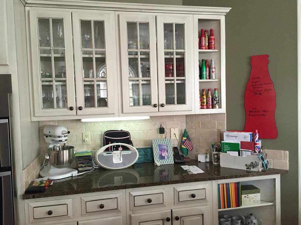 This kitchen countertop has too many personal things. It only helps to distract buyers.