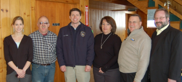 Meeting and talking with Billy Assemblyman Billy Jones (third from left) is flanked at last Tuesday's meeting at the town hall   by ROOST's Michelle Clement and Piercefield Supervisor Neil Pickering (at left) and at right by Tupper Lake Supervisor Patricia Littlefield, Councilman Mike Dechene and Superintendent of Schools Seth McGowan.  They were joined by by about 15 others that morning to put questions to the newly elected state official.  (McClelland photo)