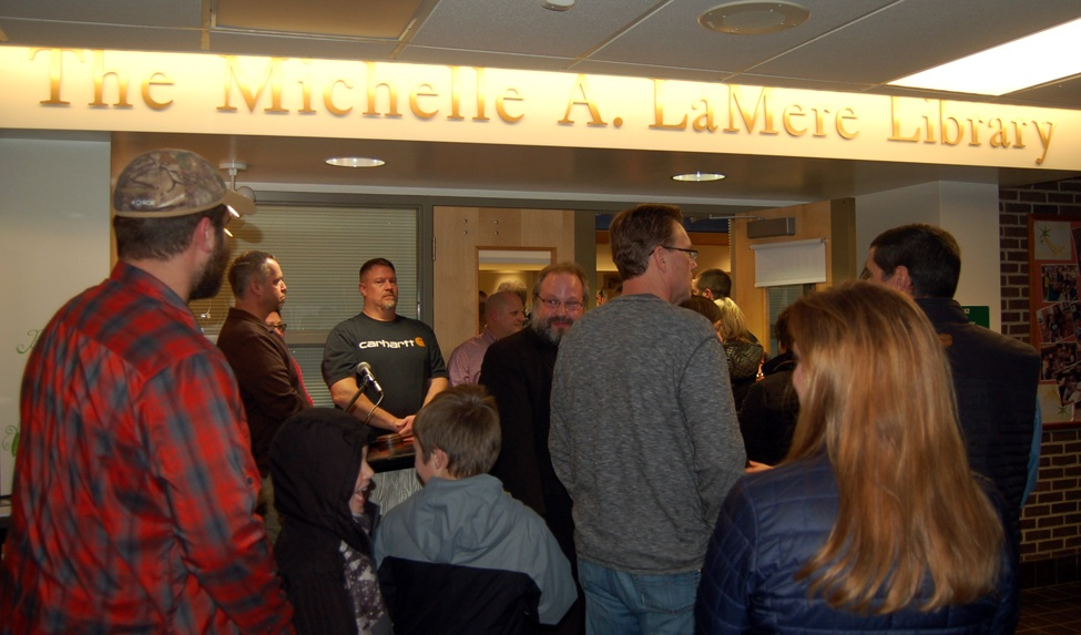 Family and friends of Michelle LaMere entering The Michelle A. LaMere Library for refreshments after the ceremony.