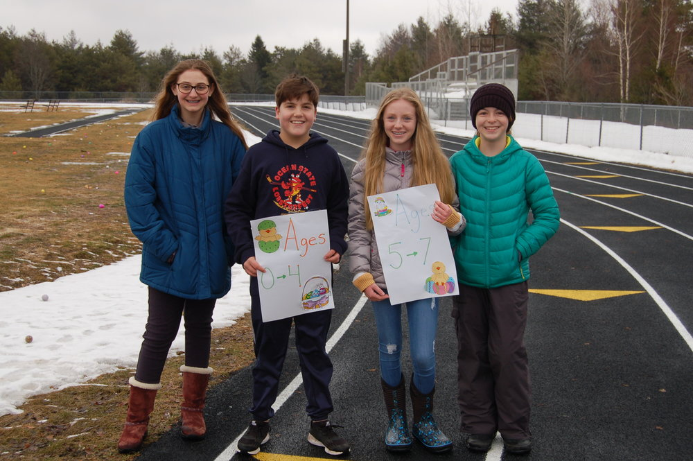 Middle schoolers Rachel Sorensen, Garrett Dewyea, Lexi Sabin and Emelia Foote volunteered on Saturday to help the younger ones navigate to their appropriate easter egg hunting ground.