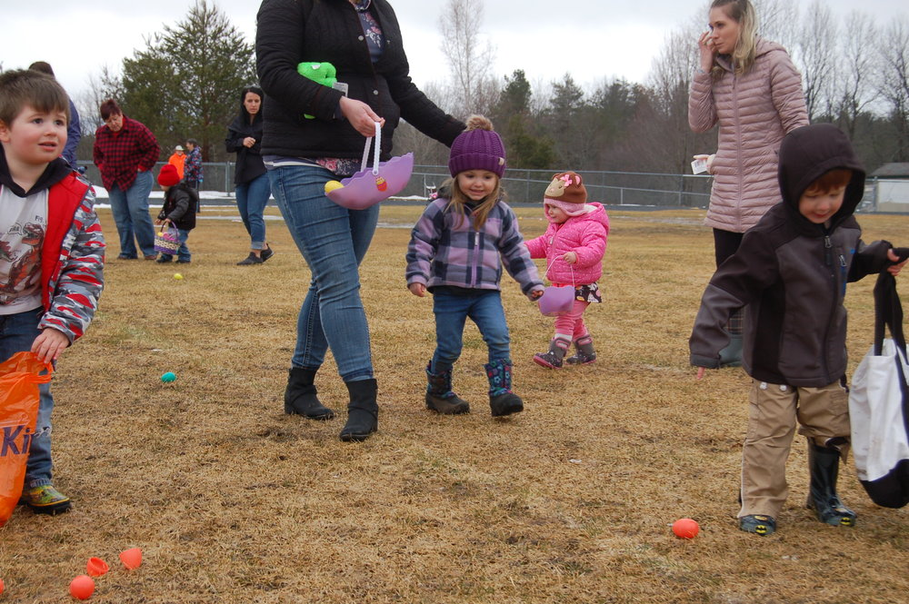 Nolan LaQuay, Estelle LaBarge, and Abigail Boushie in great excitement hunting for eggs.