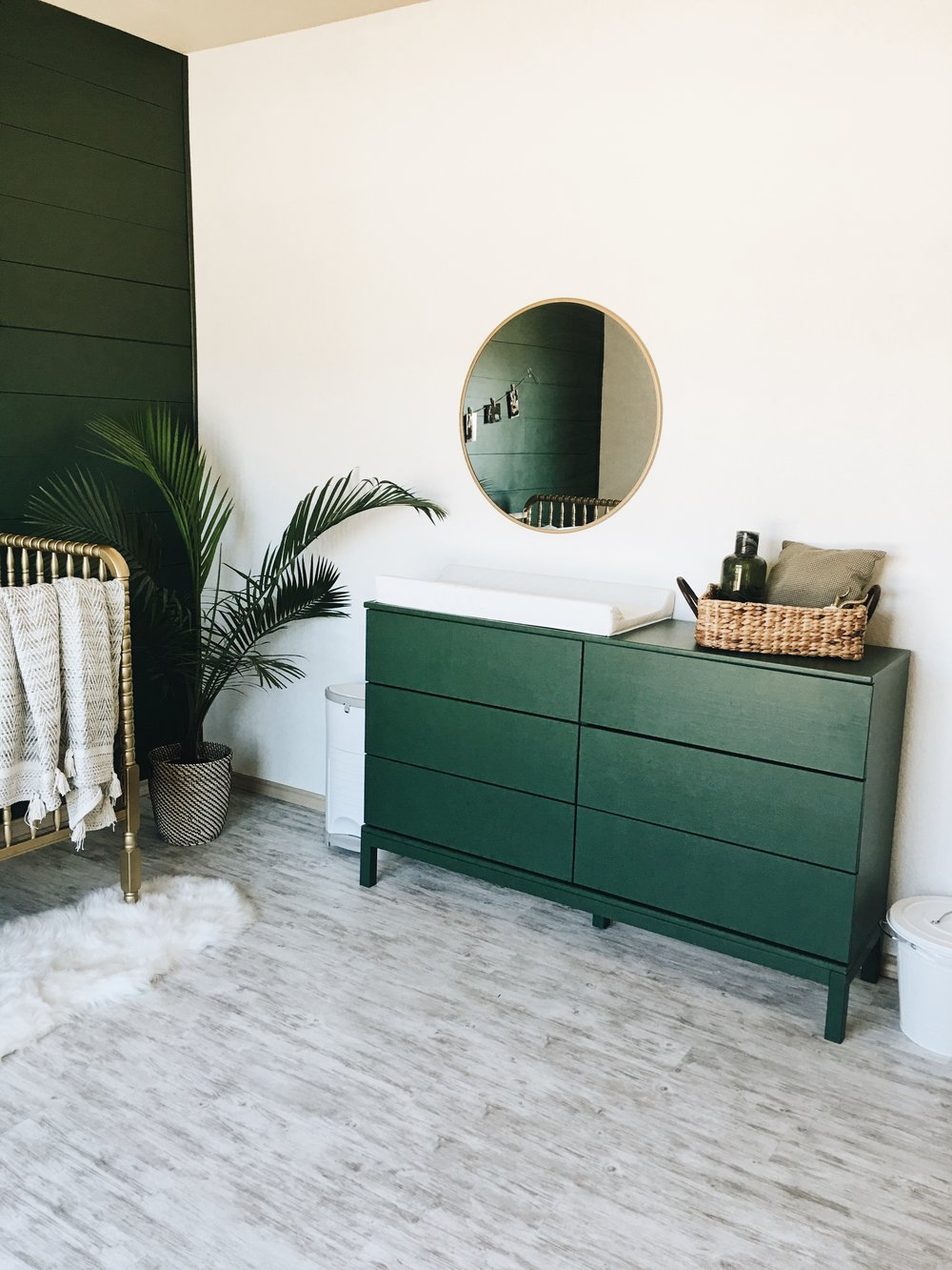 Dresser painted emerald to tie into wall - we are anxiously waiting for the gold hardware to arrive
