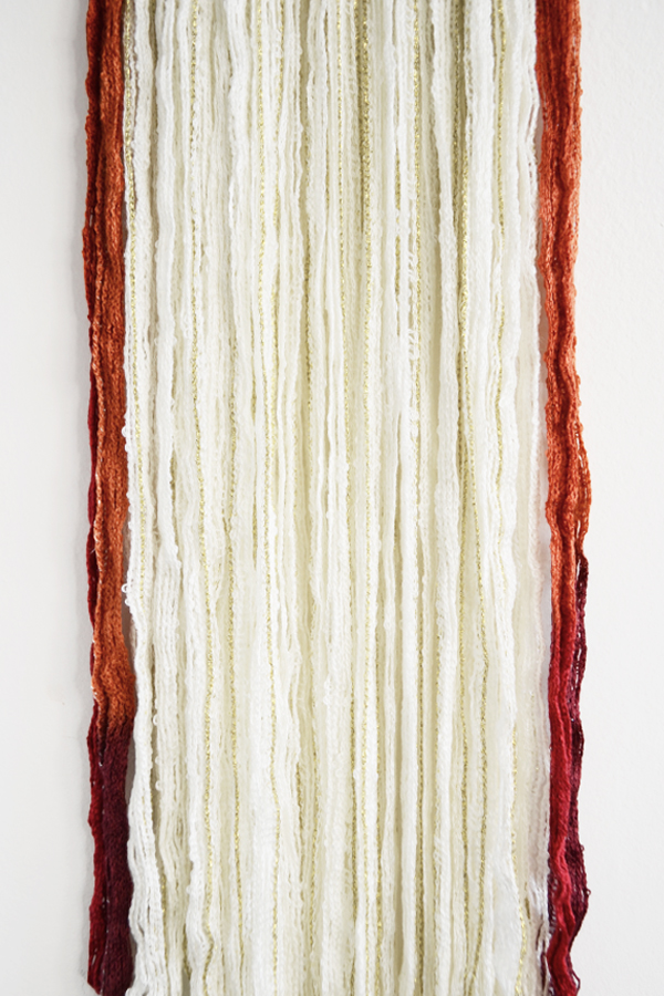 diy yarn wall hanging for fall from drawn to diy - 06