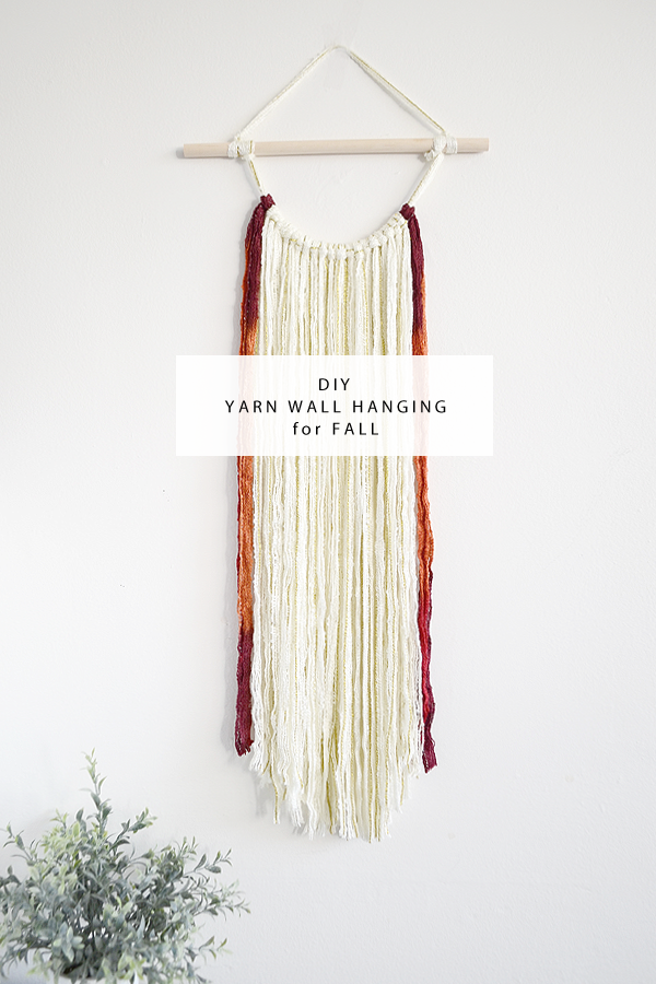 diy yarn wall hanging for fall from drawn to diy