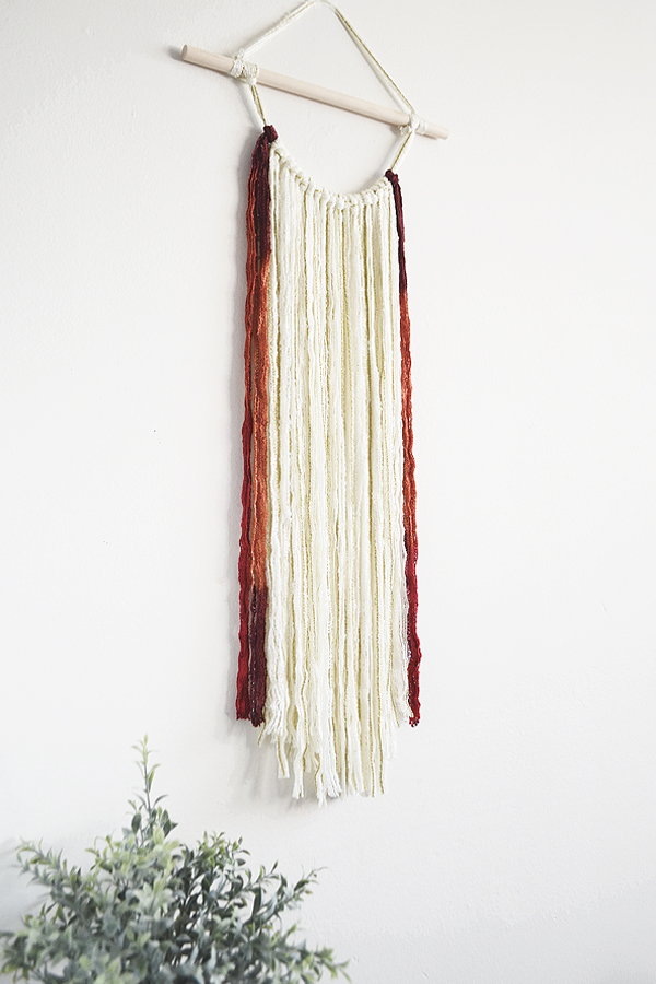 diy yarn wall hanging for fall from drawn to diy - 07