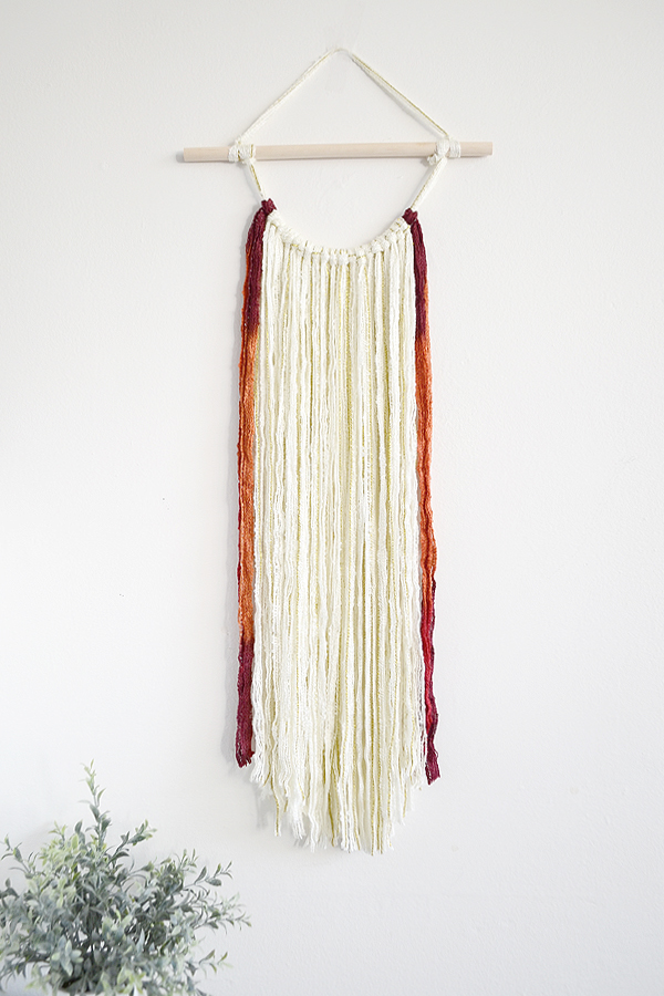 diy yarn wall hanging for fall from drawn to diy - 08