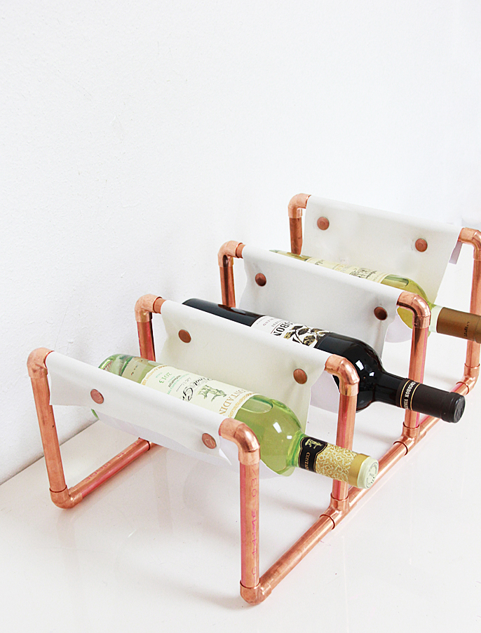 52 Weeks of DIYs | DIY Copper Pipe Leather Wine Rack by A Bubbly Life
