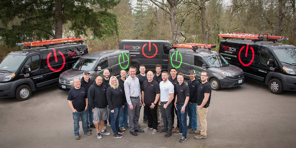 Team/Staff headshots of the ProTech Solutions team in Beaverton/Portland. This image included the removal of parking signs behind them, parking stripe and asphalt crack removal (and one head-swap)