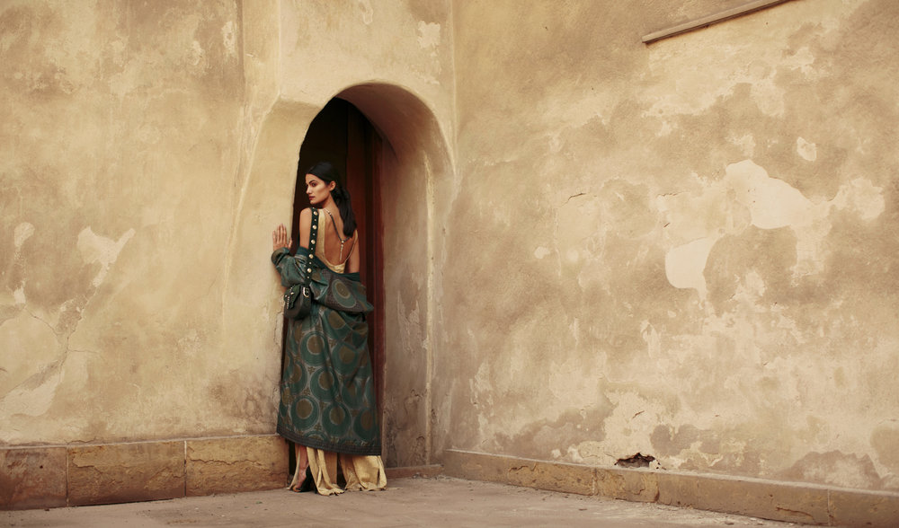 Published in Vogue Arabia Model: Tara Emad Styling: Lorand Lajos Studded Green bag : Okhtein Winter 17  Coat : Mix and Match Pendant: Azza Fahmy Production: Maison Pyramide Photography and Art Direction: Bassam Allam Location: Beit Al Suhaimy, Cairo, Egypt
