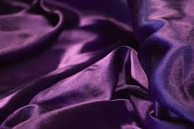 lydia, small business owner, sells purple cloth