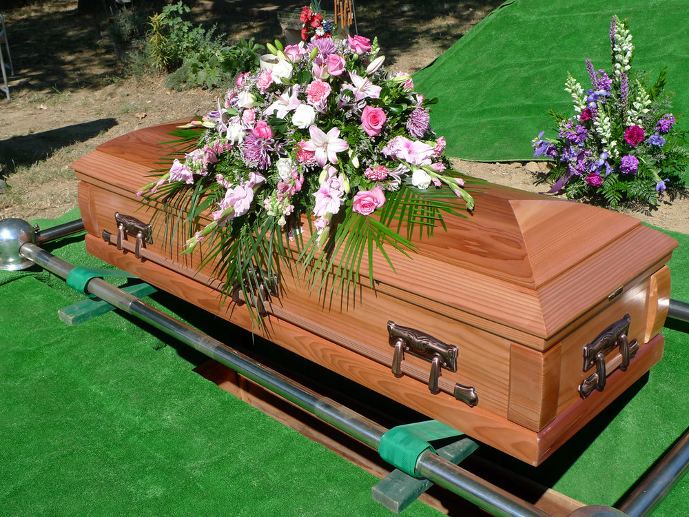 coffin with flowers jpg