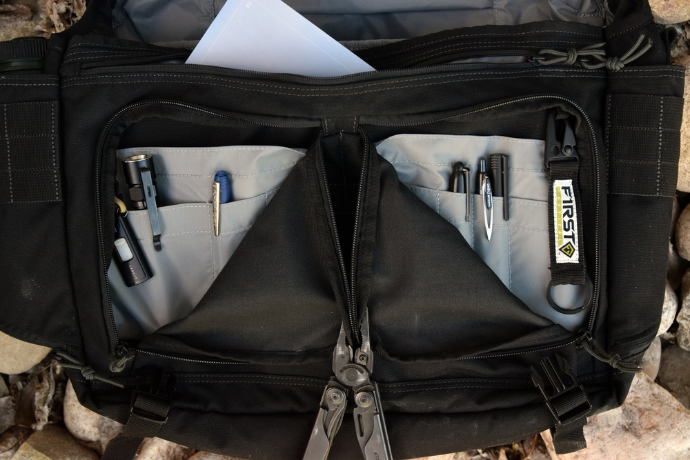 "7d26dff57b02 First Tactical has included what I will refer to as the ""Admin Pockets.""  There are a total of two separate admin pockets that are under the open top  slash ..."