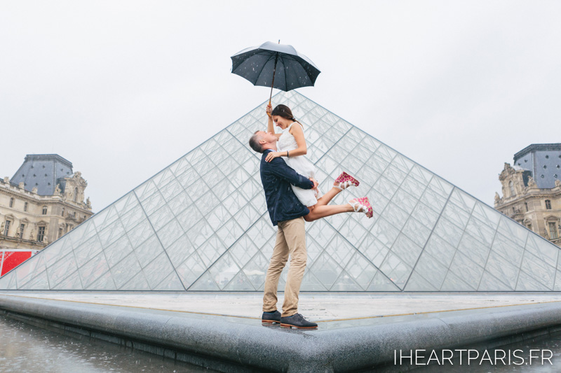 Paris Photographer Couple Session Rain Louvre Pyramid Umbrella Iheartparisfr