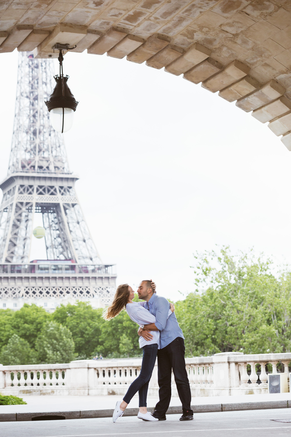 Photographer-in-Paris-Couple-Session-Bir-Hakeim-Eiffel-Tower-lovebirds-fun-Iheartparisfr.jpg