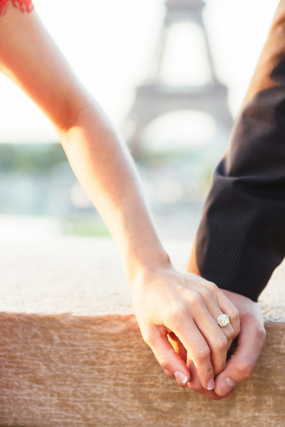 paris photographer engagement ring eiffel tower