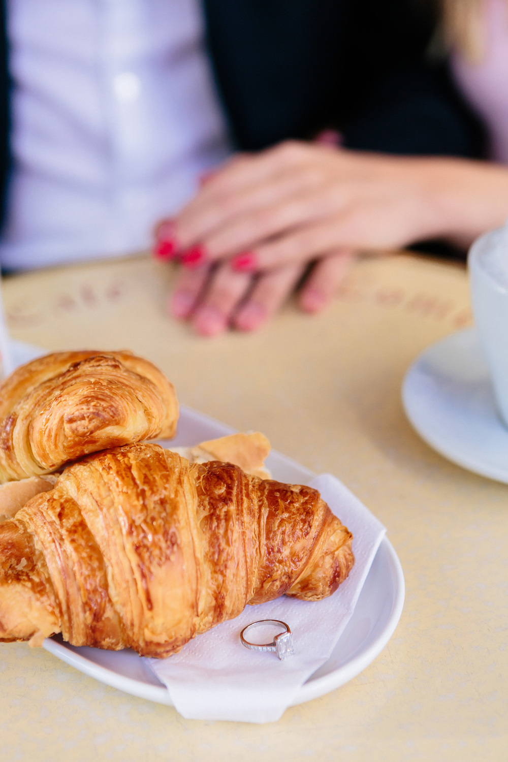 photographer in paris engagement ring café croissant