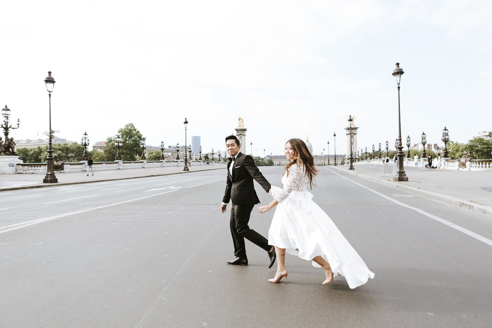 paris photographer federico guendel pre-wedding couple portrait session running across alexandre III bridge