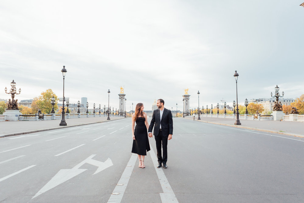 paris photographer federico guendel engagement couple portrait session standing holding hands on alexandre III bridge