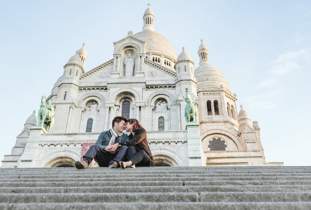 paris photographer surprise proposal couple at the steps by sacre coeur in montmartre