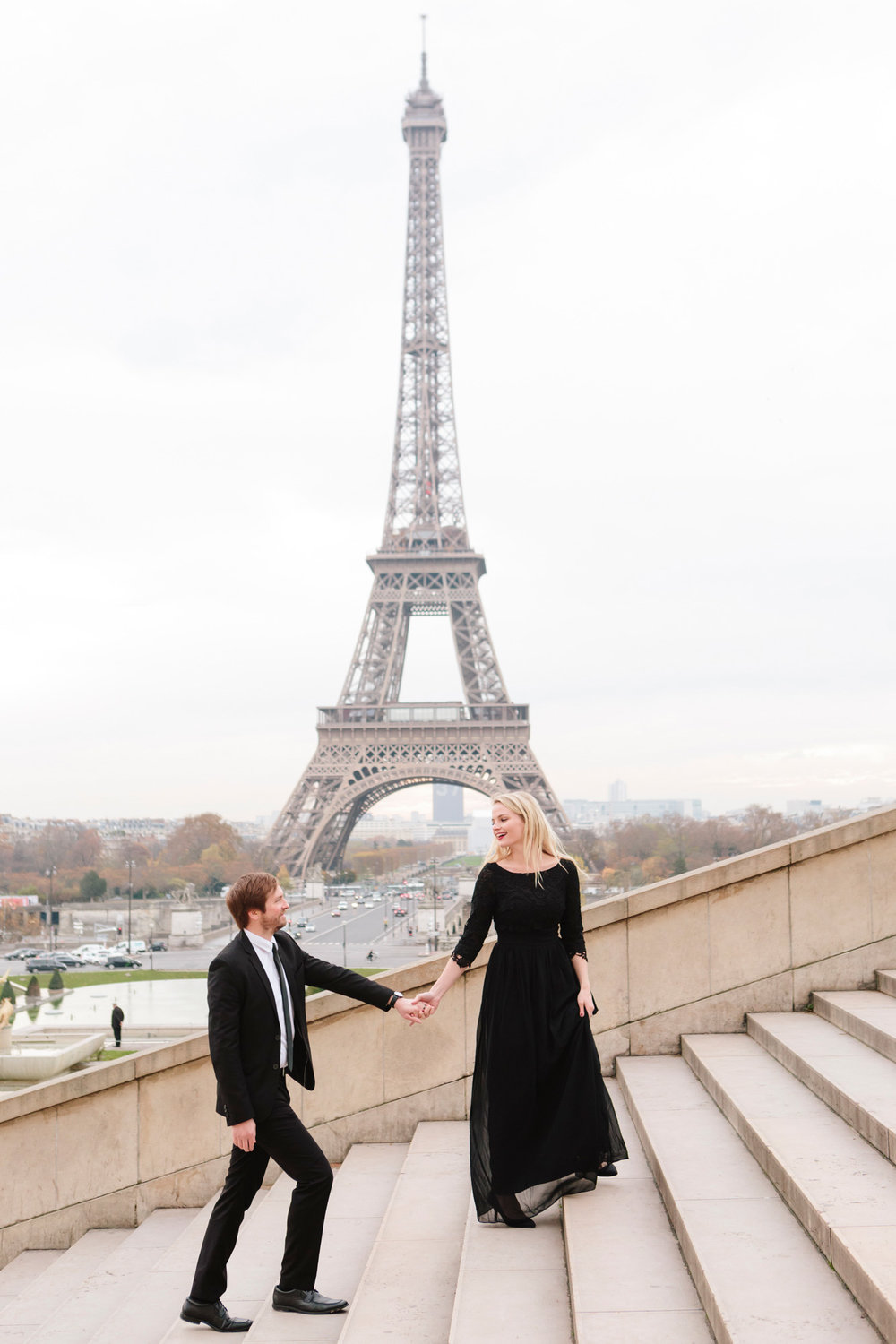 Couple engagement session steps at Trocadero with the view of the Eiffel Tower captured by Photographer in Paris Federico Guendel