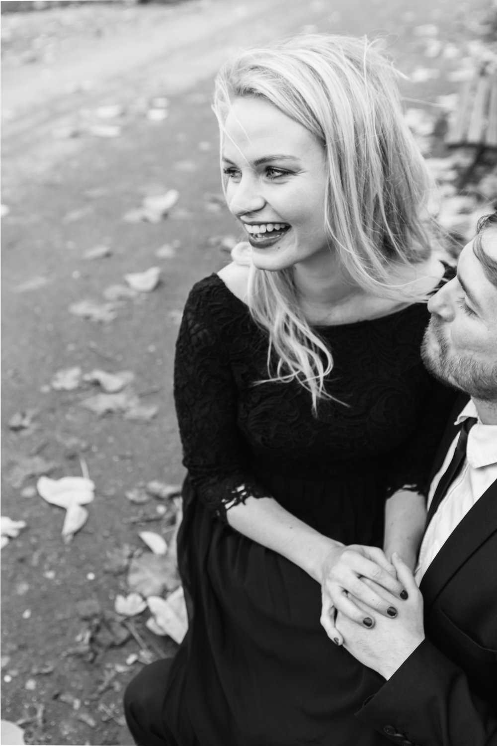 Couple engagement session portrait in black and white by the Eiffel Tower captured by Photographer in Paris Federico Guendel