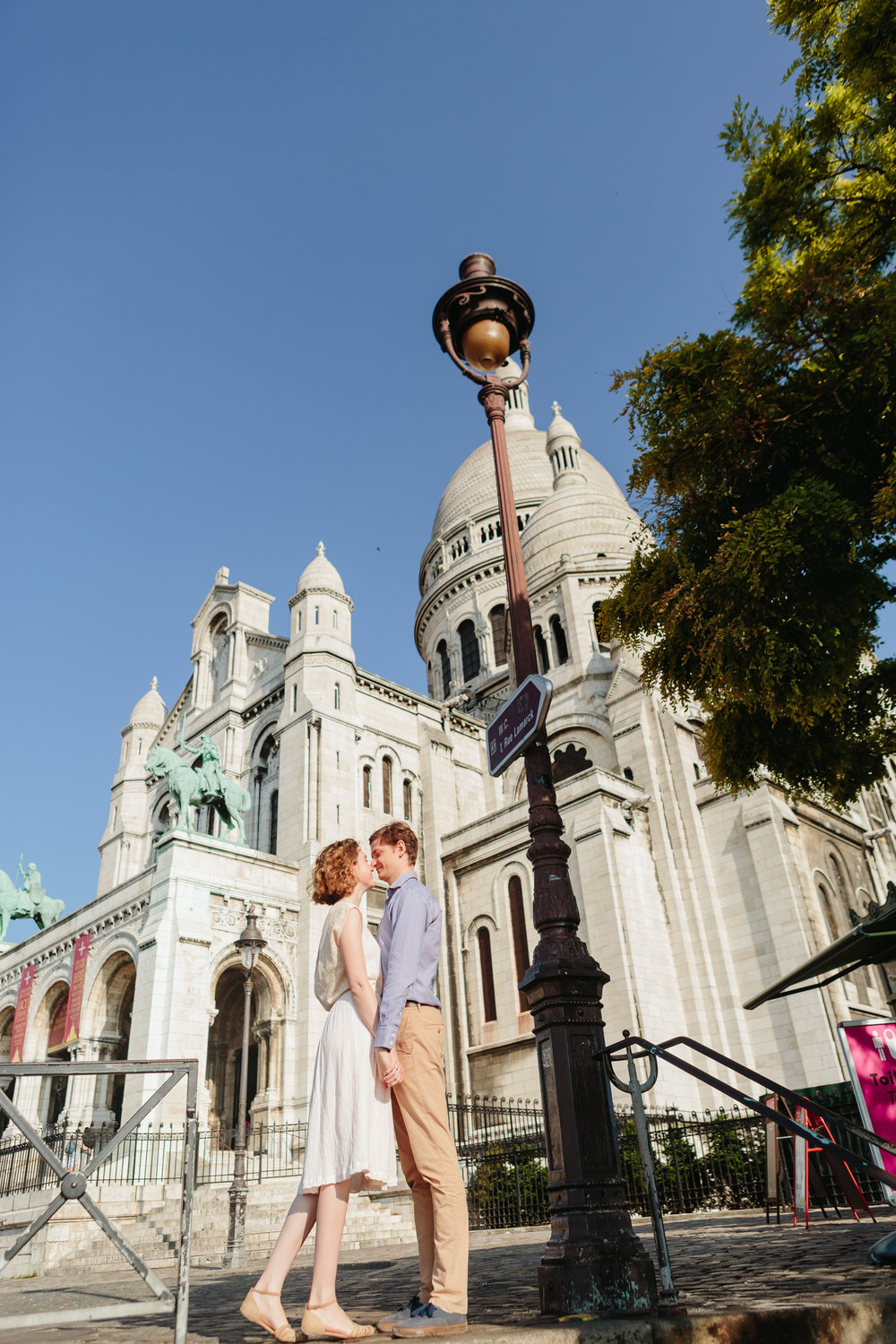 Couple in love holding hands by Sacre Coeur Cathedral at Montmartre captured by Paris Photographer Federico Guendel IheartParisFr