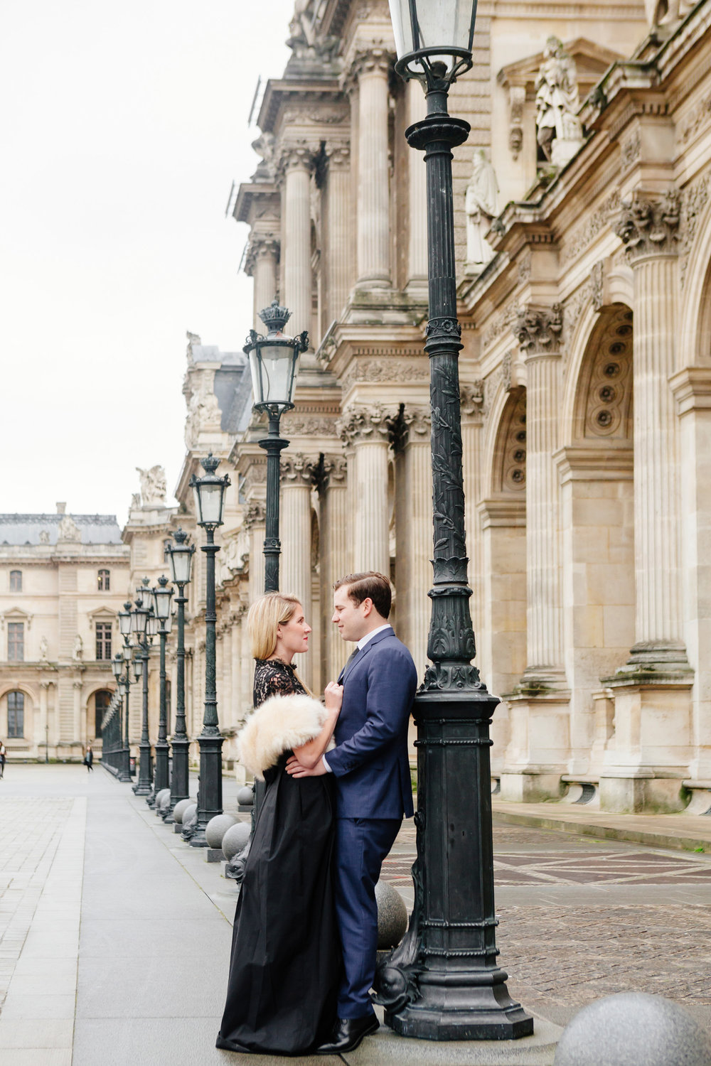 Paris vacation couple portrait standing in the courtyard of Louvre Museum captured by Paris Photographer Federico Guendel www.iheartparis.fr