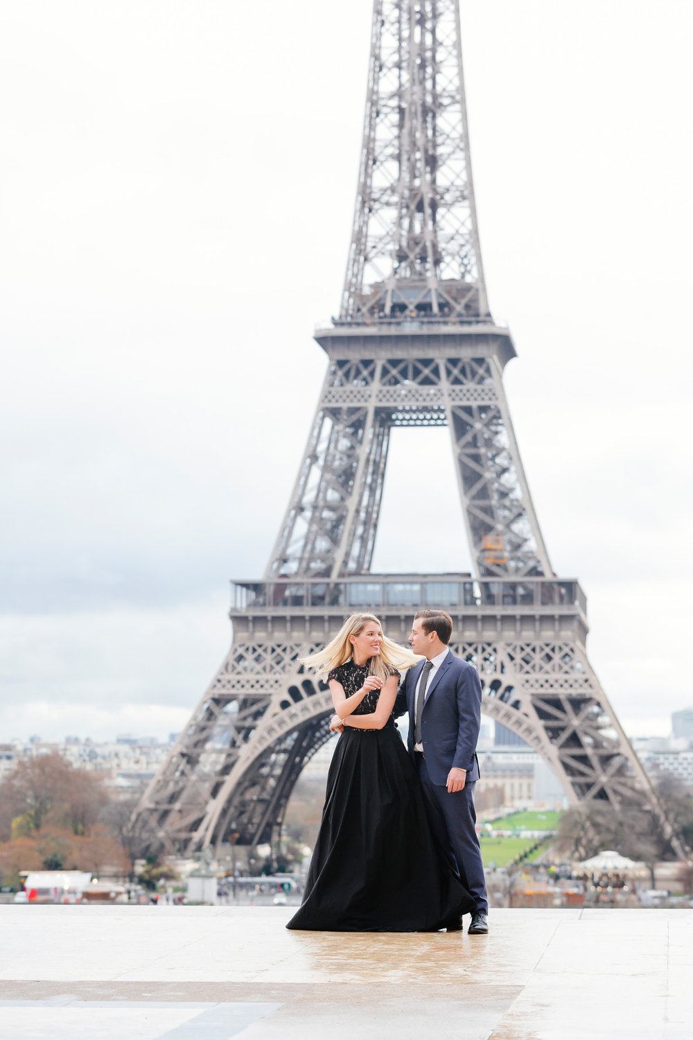 Paris vacation romantic couple portrait dancing at Trocadero with the view of Eiffel Tower captured by Paris Photographer Federico Guendel www.iheartparis.fr