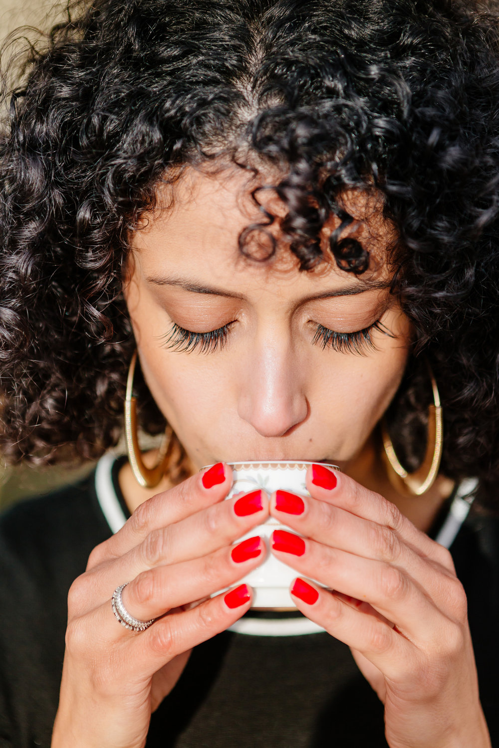 Close up portrait of a girl drinking coffee captured by Paris Photographer Federico Guendel IheartParis www.iheartparis.fr