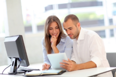 Couple-working-on-Computer-and-iPad.jpg