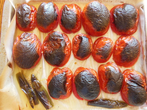 Broil unti tomato and chile skins are blackened.