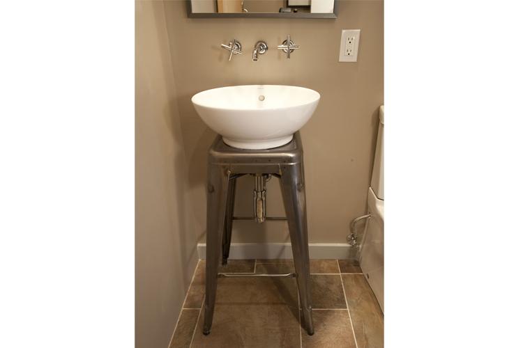 A custom laser-cut Marais metal stool, adapted for use as a sink