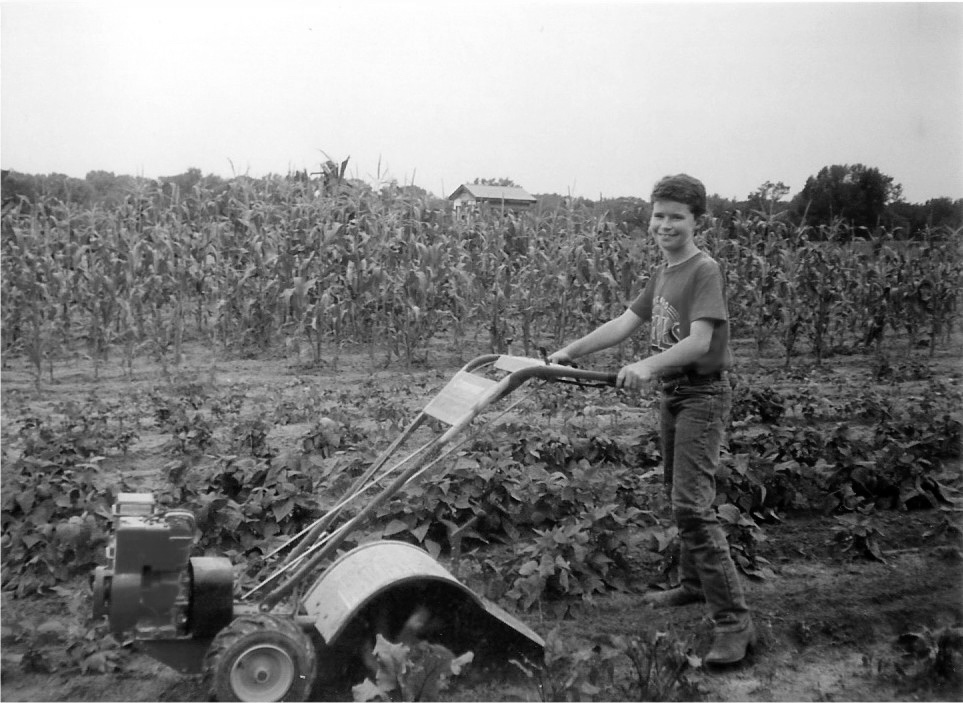 Sam tilling the gardenbw.jpg
