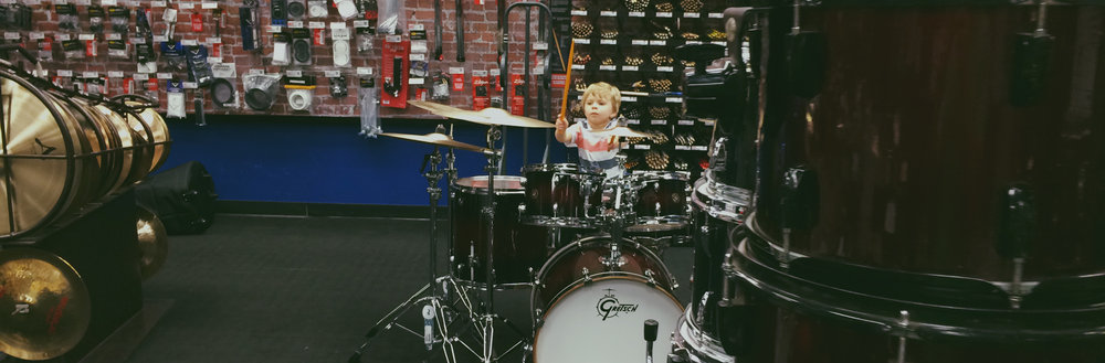 Sawyer at Guitar Center. His new favorite place to spend his time. Daddy is totally ok with that.