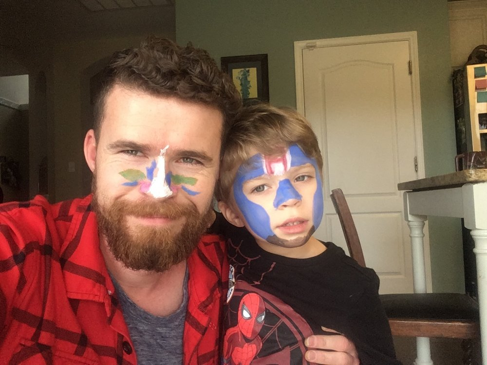 "Sawyer loves face paint. Here he is as Captain America with a brown chin strap, and I am the ""antagonist."" Sawyer asked me if he could paint my face. I accepted."