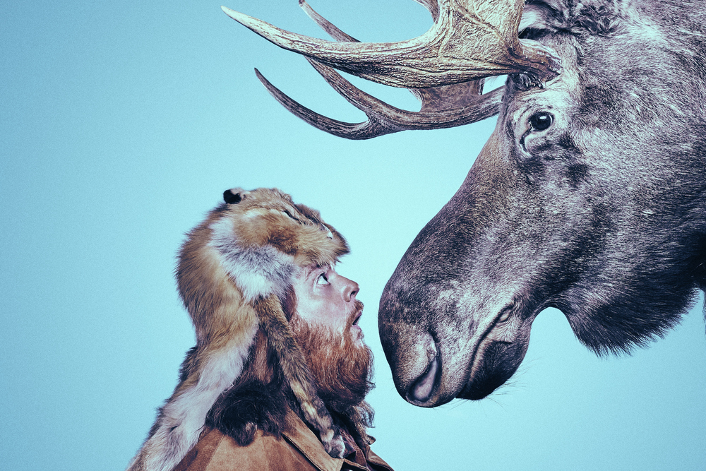 "Torry Martin face to face with a moose for his book ""Of Moose and Men""."