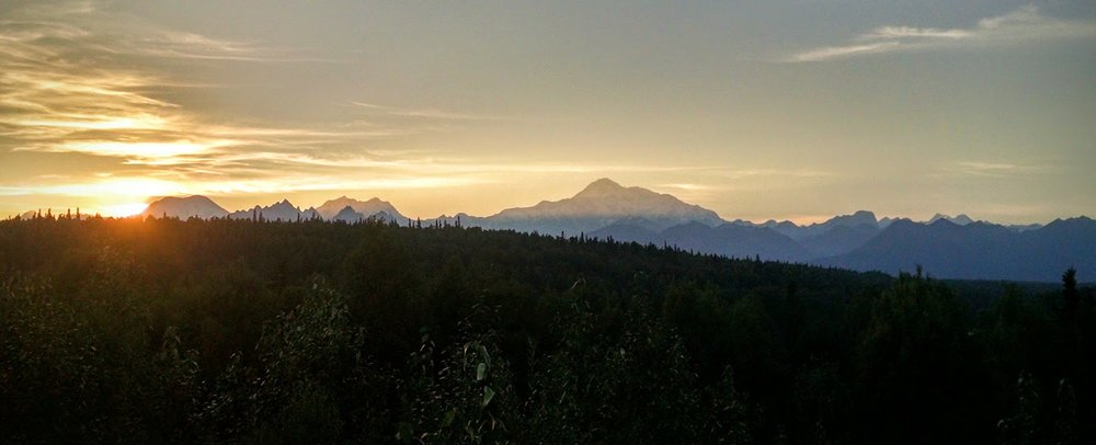 11 pm and the sun still has not completely set across the Denali range