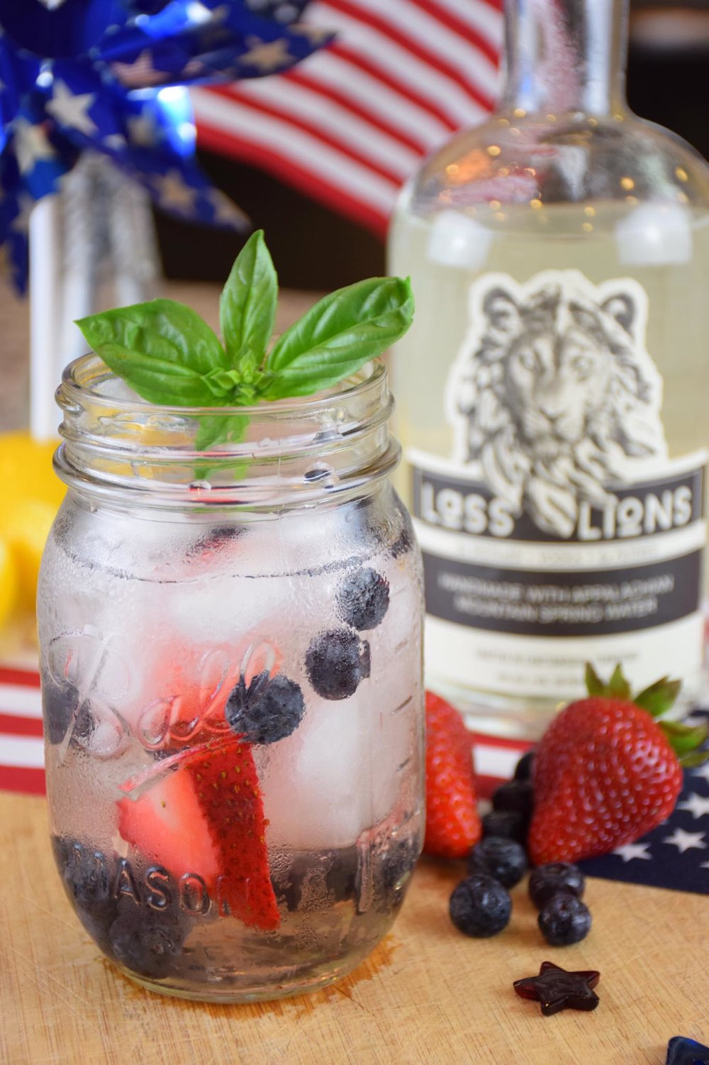 Cat's Meow aka Berry America - Ingredients:·       2 oz. Lass & Lions craft vodka·       1 oz. part Elderflower Liqueur·       ½ oz. fresh lemon juice·       splash simple syrup·       muddled strawberry and blueberry·       sparkling roséCraft: Use a mason jar.  Fill shaker with ice and combine ingredients (except sparkling rosé).  Shake then strain over fresh ice in a mason jar.  Top with sparkling rosé.  Garnish with herb, mint, strawberry, or lemon.