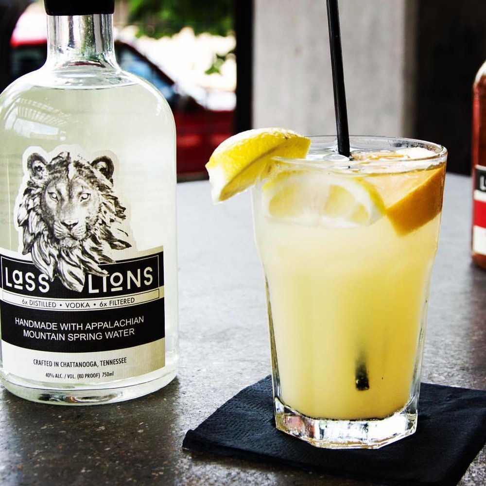 Not Your Grandma's Lemondade - Ingredients:·      1.5 oz. Lass & Lions craft vodka·      dash vanilla·      dash simple syrup·      top with lemonadeCraft:·      Serve in highball or Collins·      squeeze fresh lemon on top, leave peel·      garnish with sliced lemon