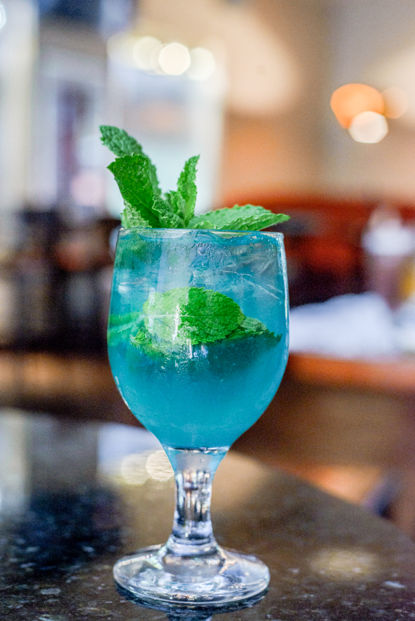 Big Blue Mule - For all you Kentucky fans!Ingredients:2 oz. Lass & Lions Desire Vodka1/2 oz. blue curaçao1/2 oz. lime juice2 dash Woodford aromatic bittersMintGinger beerCraft:Add Desire Vodka, blue curaçao, bitters, lime, and mint into shaker and muddle.  Fill shaker with ice and shake.  Strain into glass, fill with ice, and top with ginger beer.  Garnish with mint.