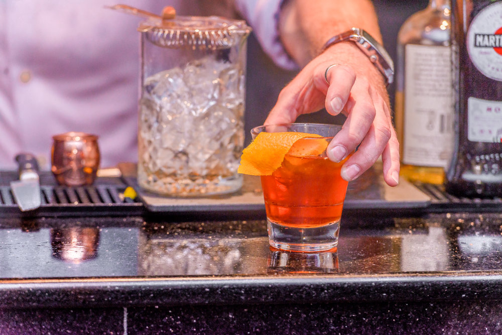 Fighting COCKtail - For all you South Carolina fans!Ingredients:1.5 oz. Lass & Lions Unwind Vodka1 oz. Aperol1 oz. sweet vermouth2 dash orange bitters Craft:Add all ingredients into mixing glass, fill with ice, and stir for 15 seconds.  Strain into rocks glass and fill with ice.  Garnish with orange.