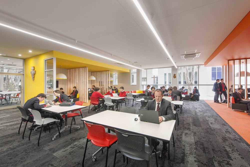 Rostrevor College | Library + Classroom Refurbishment   Services: BESTEC Contractor: Shape Constructions Photographer: David Sievers Photography  Staged redevelopment of existing library space in order to provide a contemporary learning space and equity centre. Multiple classrooms were also re-furbished to update existing facilities.