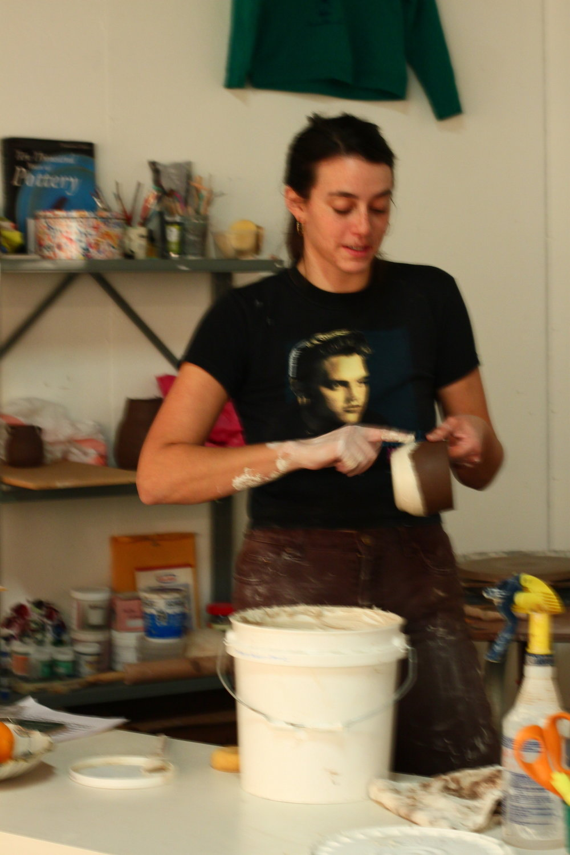 applying porcelain slip to black porcelain cup.jpg