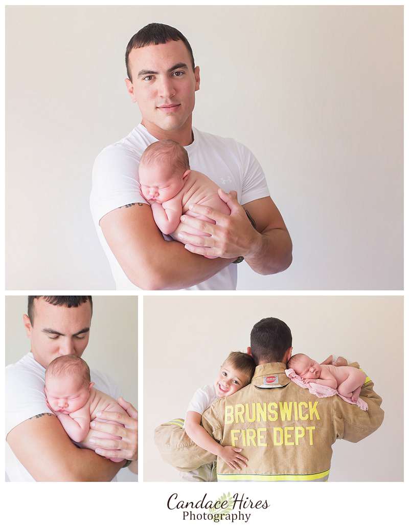 firefighter photographer with newborn baby girl
