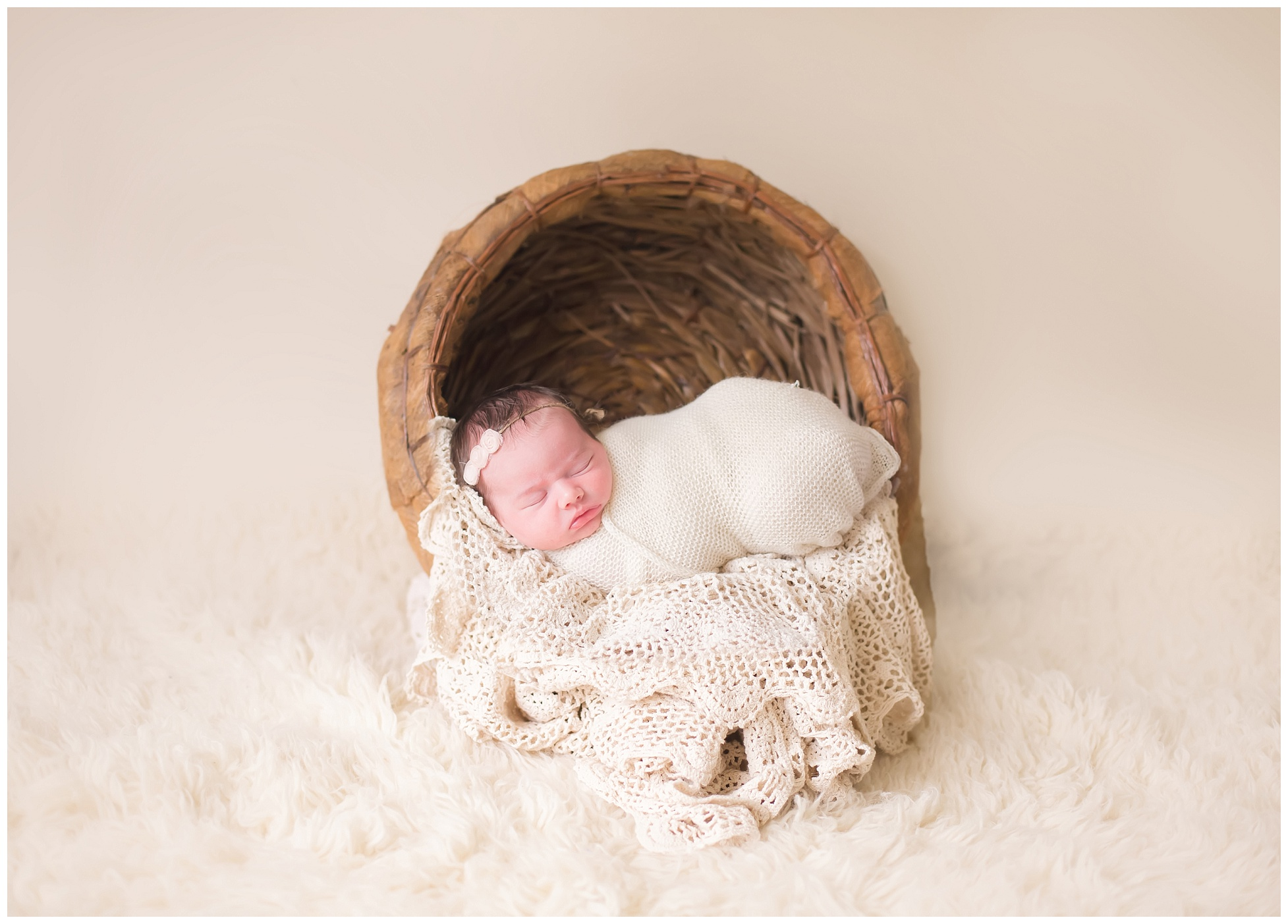 newborn baby girl in peach basket