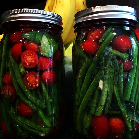 tomatoes, green beans, and garlic shoots