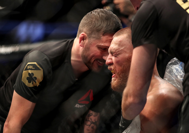 (SOURCE: Tom Hogan/INPHO) John Kavanagh coaches Conor McGregor between rounds at UFC 202 in his rematch with Nate Diaz.